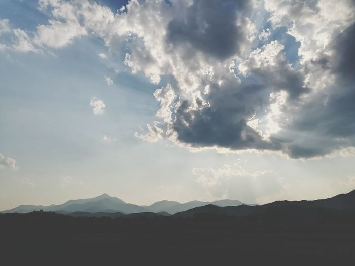 Scenic view of silhouette mountain against sky