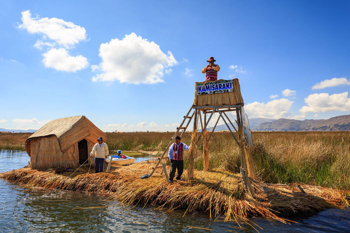 Kamisarak Laguna Titicaca Lake Totora Uros Architecture Beauty In Nature Boys Building Exterior Built Structure Full Length Indigenous  Landscape Leisure Activity Lifestyles One Person Outdoors People Peruvian Real People Sky Southamerica Standing Water Young Adult