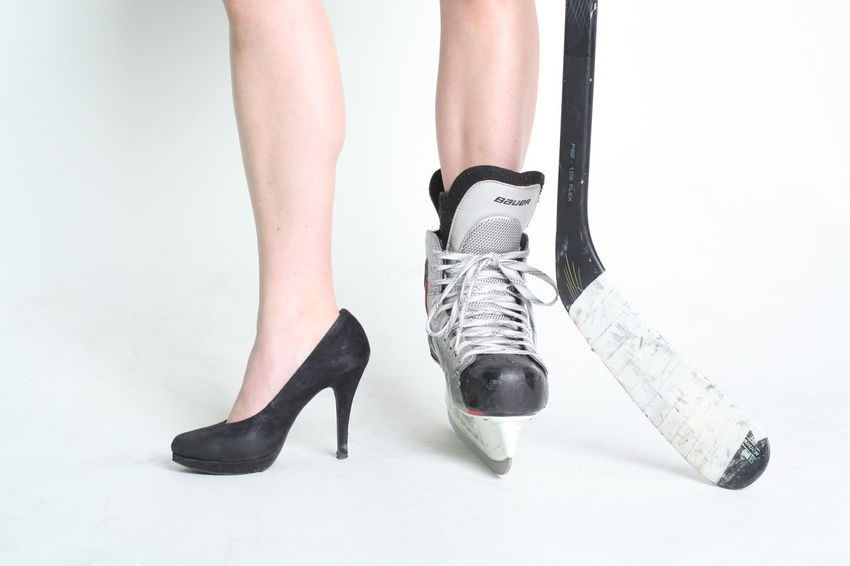 Hockey Girl shows shoes Hockey Fans Ice NHL Puck Shoe Adult Adults Only Close-up Day Fan Girl Girly Hockey Hockey Game Hockey Game! Hockey Shoe Hockey Sticks Human Body Part Human Leg Indoors  Low Section One Person People Shoes White Background Women Young Adult ıce
