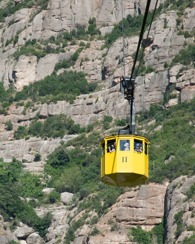 Adventure Cable Car Day Formation Land Mode Of Transportation Mountain Mountain Range Nature No People Outdoors Overhead Cable Car Rock Rock - Object Rock Formation Rocky Mountains Solid Transportation Travel Yellow
