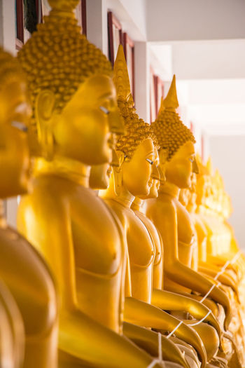 Buddha image in the temple. Close-up Day Golden Color Human Representation Idol Indoors  No People Religion Sculpture Spirituality Statue