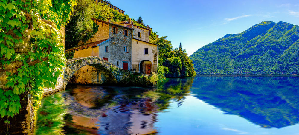 Loved my vacation to Italy, my first day was spent at lake Como, it's surrounded by little villages, with mazes of narrow streets, and stairs, that lead to amazing sight scenes like this. Bridge Cloud - Sky Como House Italy Lake Landscape Landscape_Collection Landscape_photography Mountain Nesso Old Reflection Scenics Sky Tranquility Travel Travel Destinations Travel Photography Traveling Vacations Vegetation Water