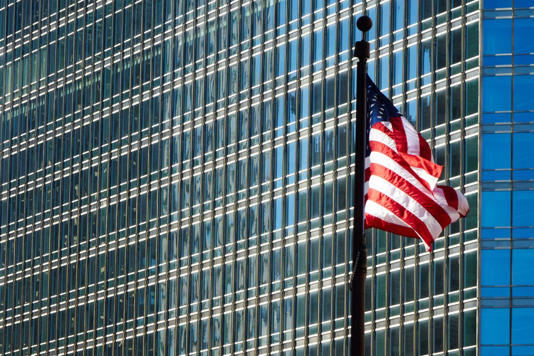 looking up at at the flag against a backdrop of buildings American Flag Architectural Detail Architecture Chicago Flag Learn & Shoot: Simplicity Pattern Urban Geometry Urban Landscape Pattern Pieces The City Light