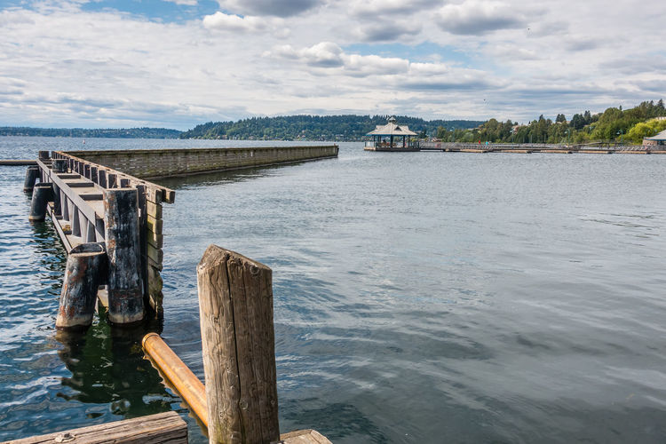 Boat launch pier in Renton, Washington. Pier 39 Architecture Beauty In Nature Bridge Built Structure Cloud - Sky Connection Day Nature No People Outdoors Post River Scenics - Nature Sky Tranquil Scene Tranquility Transportation Water Wood - Material Wooden Post