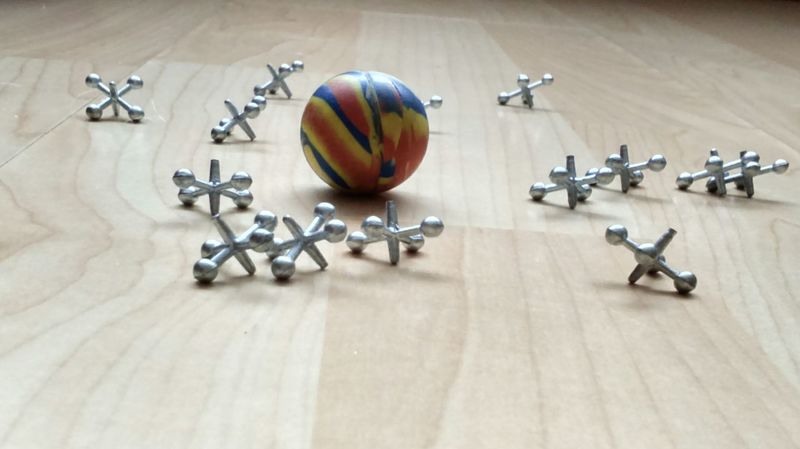 Who used to play this? Jacks Jack Ball Bouncy Ball Colourful Balls Silver  Metal On The Floor On The Ground Childhood Memories Childhood Games Memories Landscape Game Games Old Games Old Old Fashioned. BOUNCE Pick Up Quickly Fast Skill Game Skill  The EyeEm Collection