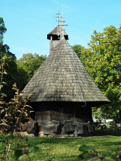 Heritage Village Plant Nature Day Tree No People Outdoors Heritage Village Bucharest Bucharest, Romania The Past Travel Photography Travel Destinations Eastern Europe Balkans Preserved Sunlight And Shadow Wooden Structure Architecture Built Structure Building Exterior Roof Grass Growth Sky