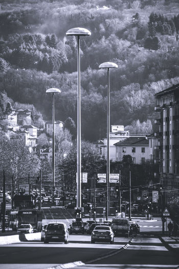 Low angle view of street light against mountains in city