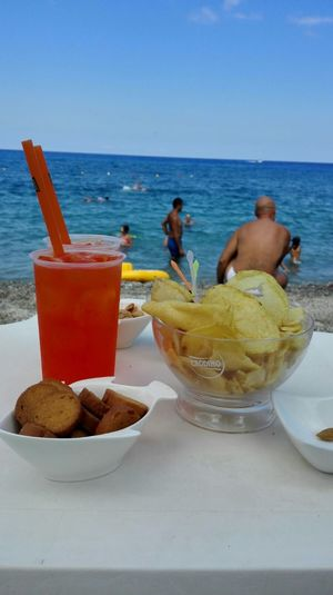 Finally On The Beach Relaxing Coctails Snack Time! Snacks! Beach Beachphotography Orange Sea Sea And Sky Deep Blue Sea People People Photography Non Recognizable People No Edit/no Filter Natural Colours Clear Water Daydreaming Scilla Italy Traveling Travel Destinations Travel Photography Travel People And Places