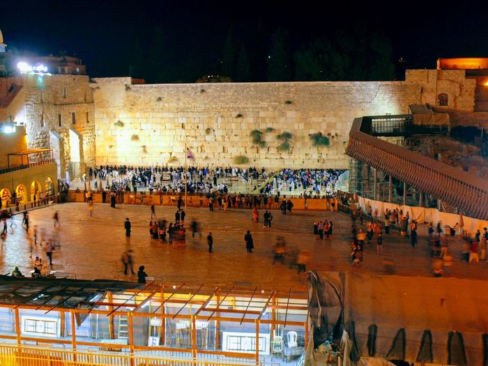 High angle view of people at wailing wall during night