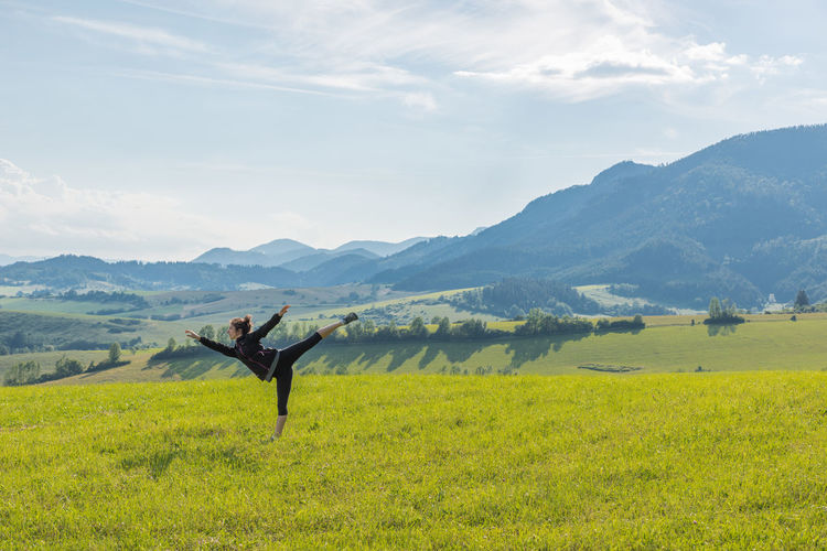 Female model exercising in the nature. Mountain Scenics - Nature One Person Landscape Field Beauty In Nature Environment Land Cloud - Sky Real People Grass Sky Nature Day Tranquil Scene Arms Outstretched Arms Raised Freedom Outdoors Posture Excercise Yoga Female Liptov Slovakia