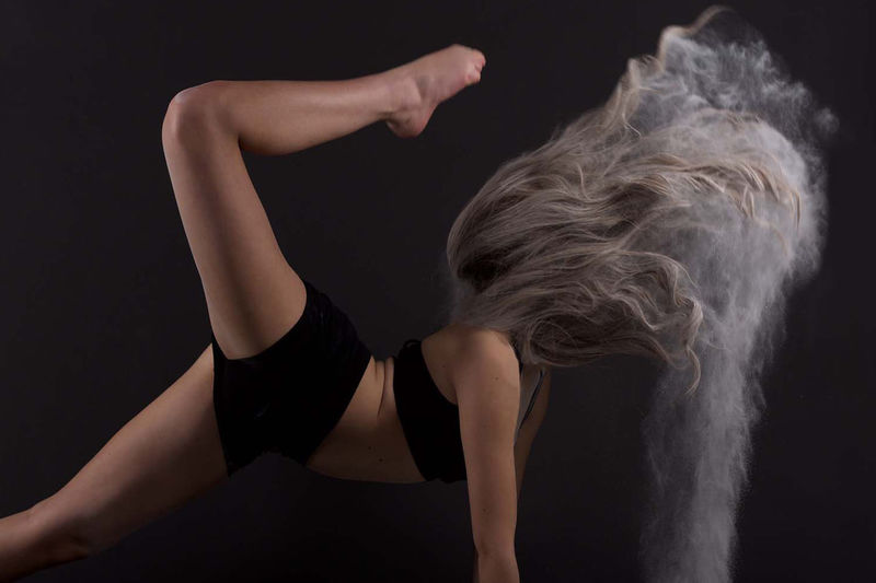 A lovely dance photo with movement accentuated with some baby powder #dancephotoshoot #powder Action Shot  Confidence  Flexibility Flexible Long Hair Person