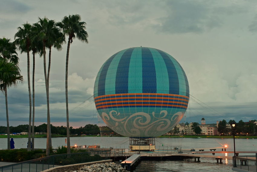 Orlando, Florida; August 23, 2018 Palms, hot air balloon and sunset skyline, in Lake Buena Vista. Walt Disney World DisneyWorld Disney Hotels Balloon Disney Store Taxi Boat Mickie Mouse Coca Cola Planet Hollywood Restaurant Art Decor Shopping Rollercoaster Disney Springs Attraction Theme Park Boardwalk Fireworks Summer Show Travel Tourism Italian Food Latin Food Magic