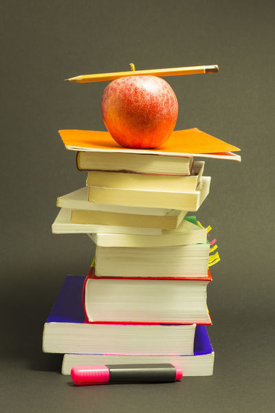 Concept of education. Stack of school books with pink marker, pencil and a red apple on top in front of dark gray background Apple Books Chaos Learning Messy Stack Apple - Fruit Back To School Book College Education Felt Tip Pen Gray Background Hardcover Book Homework Literature Multi Colored No People Orange Color Pencil Purple School Stack Studio Shot Studying