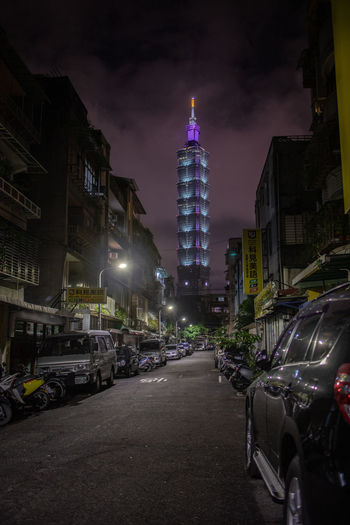 Building Exterior City Architecture Built Structure Night Transportation Mode Of Transportation Illuminated Motor Vehicle Car Building Sky Land Vehicle Tower Street Skyscraper Tall - High Office Building Exterior Nature Motion Outdoors No People Financial District  Alley Taipei 101