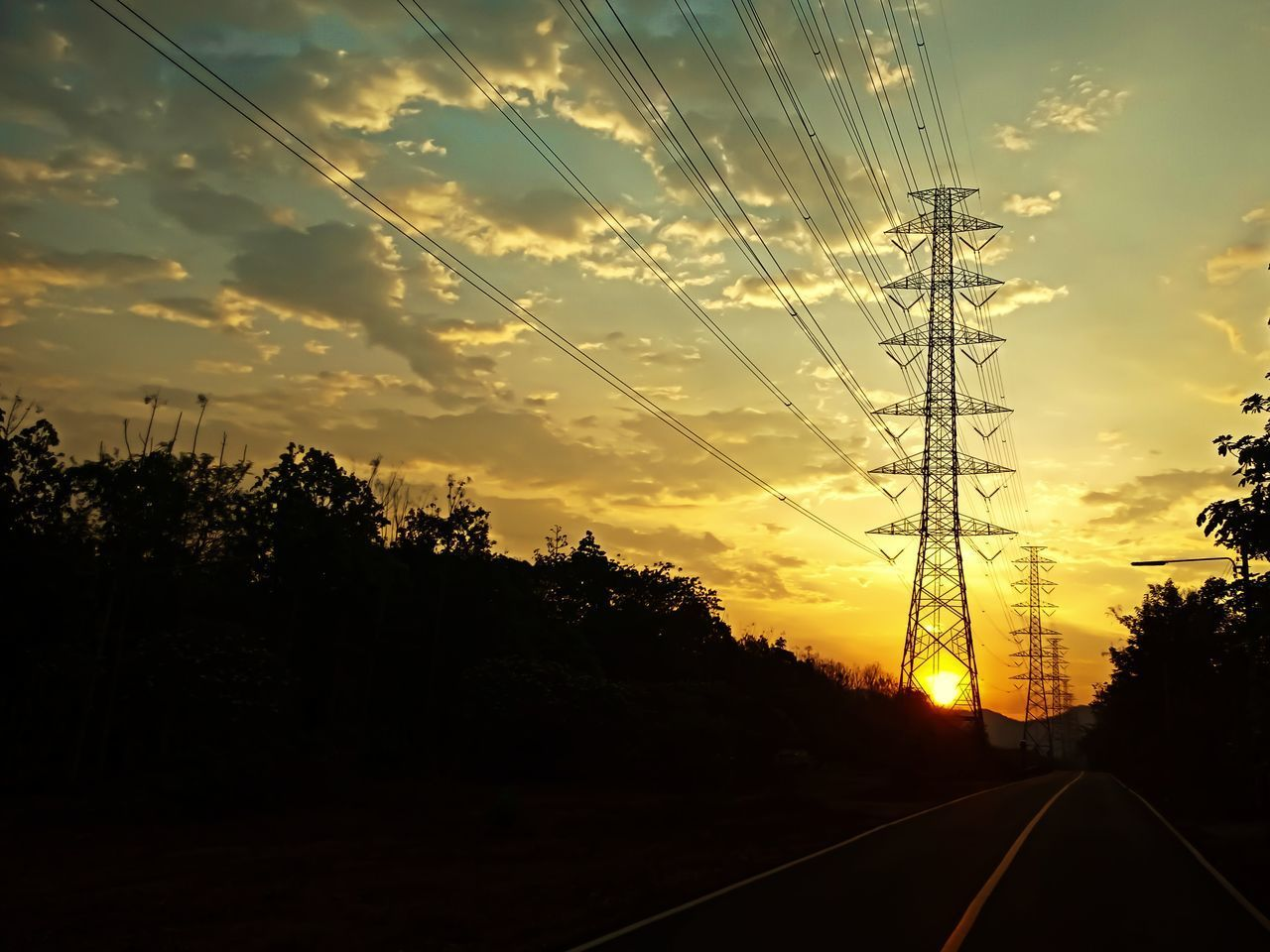 sky, sunset, plant, tree, cloud - sky, transportation, beauty in nature, orange color, electricity, nature, silhouette, no people, electricity pylon, fuel and power generation, power line, the way forward, road, direction, technology, scenics - nature, power supply, diminishing perspective, outdoors
