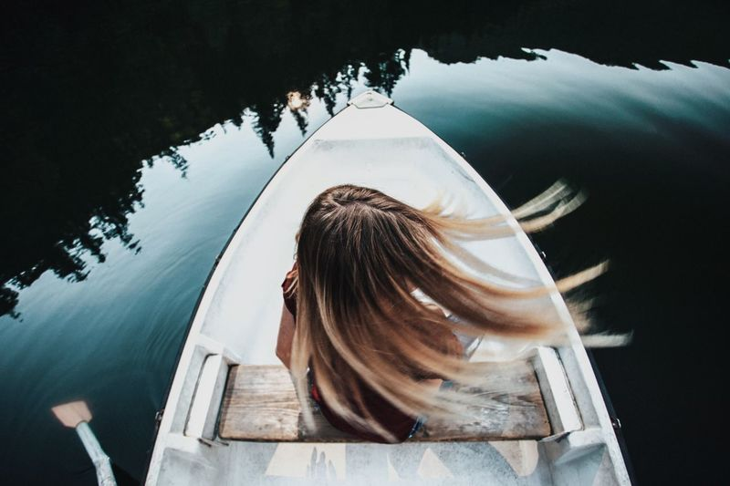 Water One Person Reflection Leisure Activity Women Lifestyles Nature Headshot Real People Day Rear View Lake Mode Of Transportation Nautical Vessel Transportation Portrait Outdoors Adult Hairstyle Boat Blond Hair Long Hair Transportation Row Girl It's About The Journey Moments Of Happiness