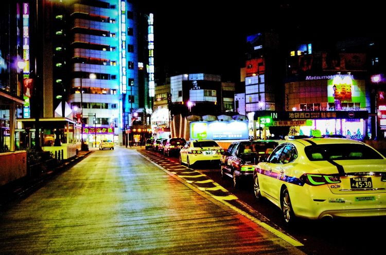 Crowded Night Illuminated Architecture Building Exterior Car City Built Structure Road No People Nightlife