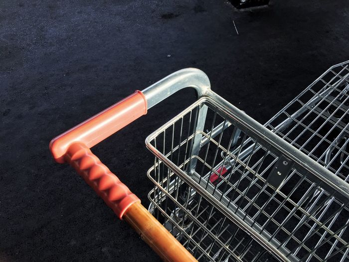 High angle view shopping cart on street