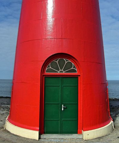 Westkapelle, Netherlands (2007) Doors EyeEmNewHere Green Lighthouse Architecture Built Structure Colorful Door Green Door Intense Colors No People Red Westkapelle