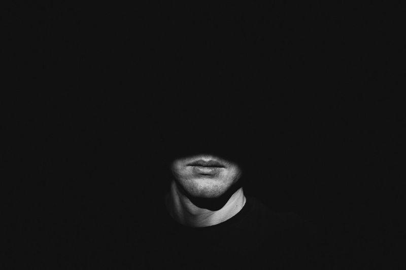 Sunlight falling on man in darkroom