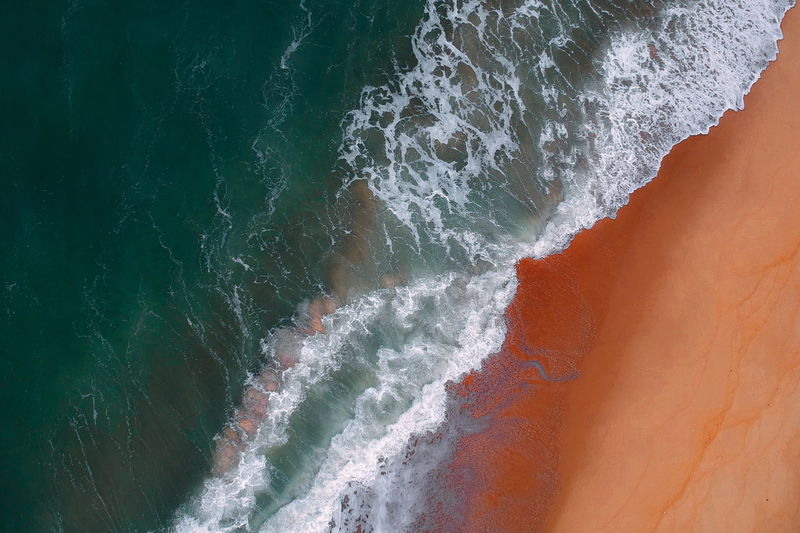 aerial view of sea waves water texture background Sea Water Motion Beauty In Nature Wave No People Aquatic Sport Nature Land Sport High Angle View Scenics - Nature Beach Day Outdoors Power In Nature Rock Non-urban Scene Breaking