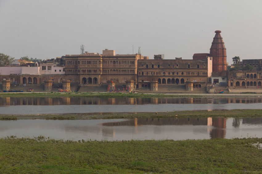 View on Kesi Ghat, Vrindavan, India from the opposite bank of Yamuna river Architecture Building Exterior Built Structure City Culture Famous Place Foggy Morning Kesi Ghat Landmark Landscape Old Town Outdoors Palace Reflection River Tourism Yamuna