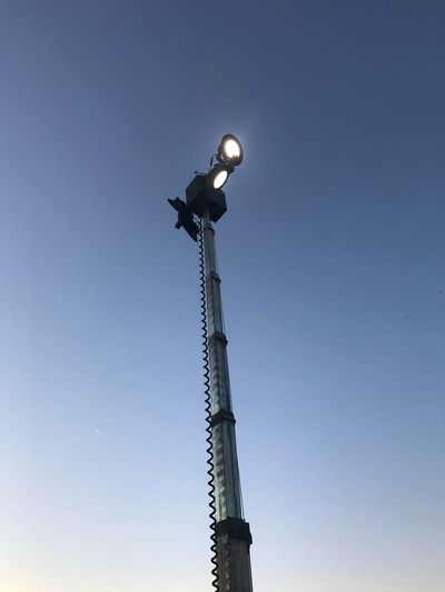 Low Angle View Lighting Equipment Blue Clear Sky Illuminated Electricity  No People Sky