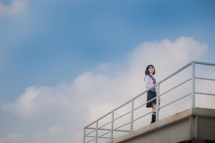 Sky One Person Cloud - Sky Lifestyles Front View Leisure Activity Architecture Young Women Real People Standing Low Angle View Railing Young Adult Women Day Nature Blue Portrait Outdoors Beautiful Woman Japan