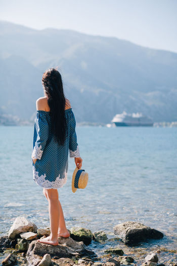 woman travel by sea on vacations Hat Relaxing Romantic Travel Travelling Vacations Beauty In Nature Day Leisure Activity Montenegro Mountain Mountains Nature One Person Outdoors Real People Rear View Relaxation Sea Sea And Sky Seascape Sky Travel Destinations Water Young Adult