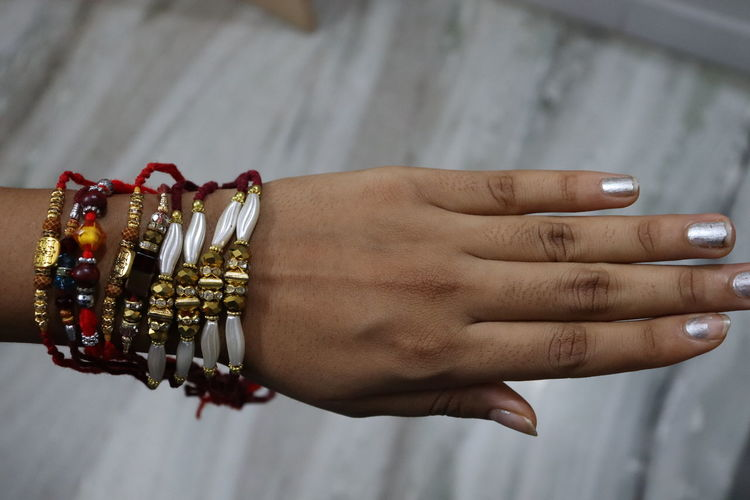 Close-up of hand tattoo against blurred background rakhi rakshabandhan festival celebration of india