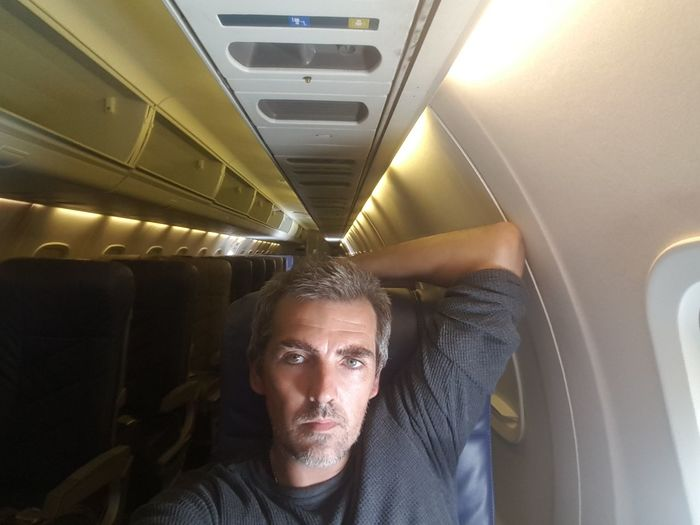Portrait of man traveling in airplane