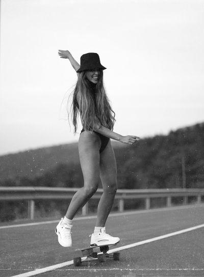 Fun skater girl black and white full body portrait