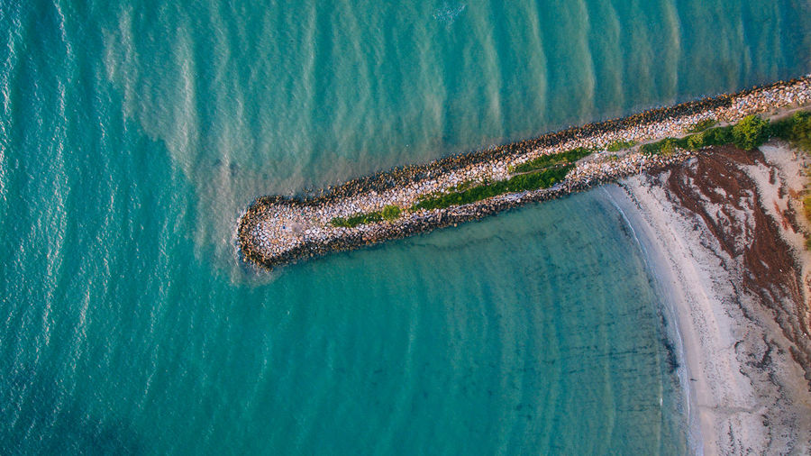 Aerial view of stone embankment or breakwater at sea with sandy beach in Labuan island,Malaysia. Beautiful Nature Tranquility Tropical Paradise Waterscape Beauty In Nature Boulder Breakwater Cutwater Day Ecology High Angle View Nature No People Object Outdoors Reed Ripples In The Water Sandy Beach Sea Seascape Seascapes Stone Embankment Stone Wall Urban Water