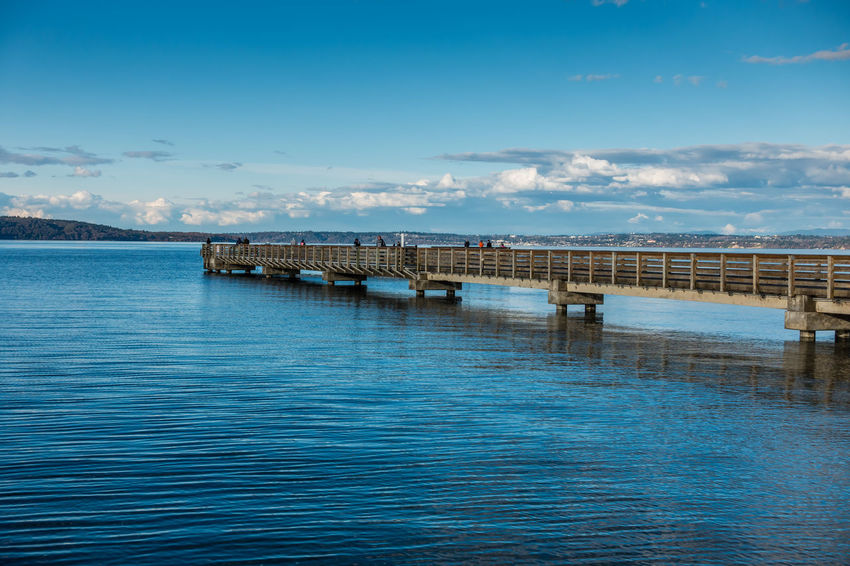 Pier on a Spring day in Dash Point, Washington. Architecture Coastline Pier Architecture Beauty In Nature Blue Built Structure Cloud - Sky Dash Point Day Marine Nature No People Outdoors Scenics Sea Shoreline Sky Water