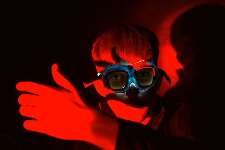 Red Red Color Fantastic Cyberspace Cyberpunk Cyber Android Retro Retrofuturism Portrait One Person Indoors  Headshot Black Background Studio Shot Men Adult Dark Fashion Subculture Unrecognizable Person Disguise Young Adult Aggression  Mask - Disguise Mask Illuminated