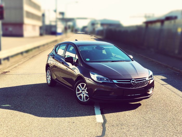 Opel Astra Car Motor Vehicle Transportation Mode Of Transportation Land Vehicle Sunlight Focus On Foreground Road Outdoors Street Sunny