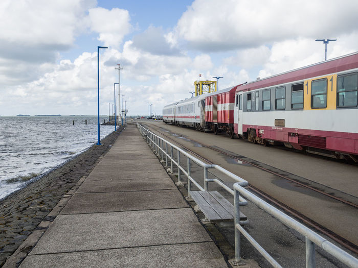 Train On Pier At Sea With Cloudy Sky, Dagebuell, Germany