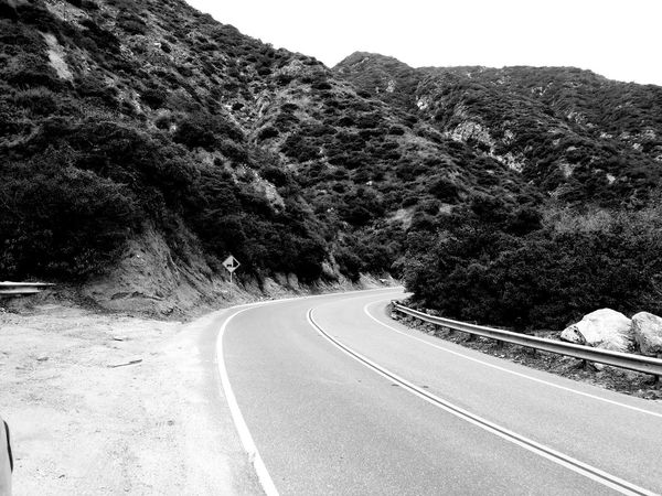 Falling Rocks Sign Mountain Winding Road Transportation The Way Forward Check This Out Copy Space Eye Em Nature Lover Still Life Photography Fine Art Photgraphy Winding Road Collection Driving Going Up Road Road Markings Non-urban Scene Vacations Leisure Activity Relaxing Lifestyles