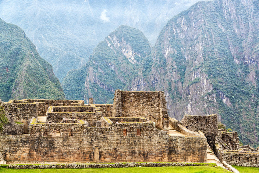Machu Picchu ruins with mountains visible in the background Ancient Andes City Civilization Culture Cusco Cusco, Peru Cuzco Famous Inca Landmark Lost Machu Picchu Mountain Old Panorama Peru Ruin Stone Tourism Travel Unesco UNESCO World Heritage Site Valley World