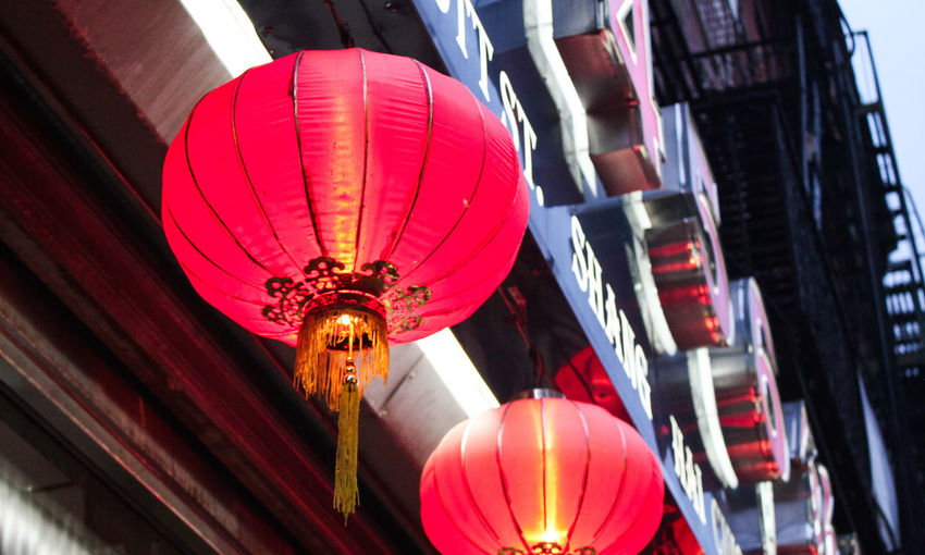 Low angle view of illuminated lanterns hanging in city