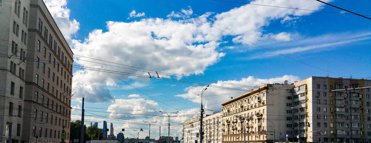 Building Exterior Architecture City City Life Moscow Russia Москва Summer Cityscape Urban Skyline City Architecture Modern Business Finance And Industry Apartment Cloud - Sky Sky Outdoors Day Blue Telephone Line No People Low Angle View Cumulus Cloud Built Structure