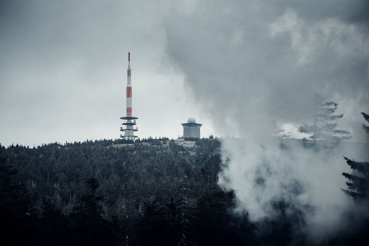 Brocken Harz Ilsefälle Ilsetal Wald Building Exterior Smoke - Physical Structure Sky Architecture Built Structure Environmental Issues Smoke Stack Factory Pollution Cloud - Sky Industry Environment Tree Nature No People Plant Tower Tall - High Chimney Air Pollution Outdoors Cooling Tower Smog Ecosystem  Harzmountains Fog Foggy Travel Destinations