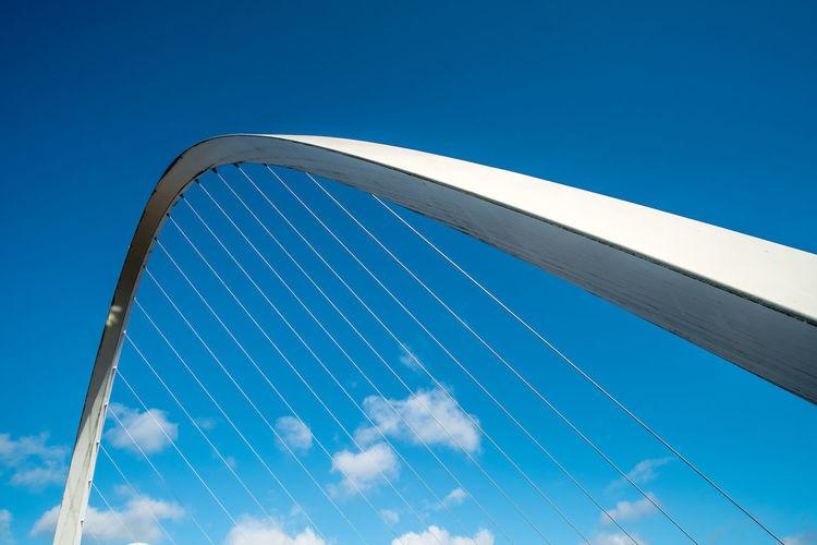 Close up of Gateshead Millennium Bridge, a pedestrian and cyclist tilt bridge spanning the River Tyne in Newcastle, England. Newcastle Upon Tyne United Kingdom Bridge
