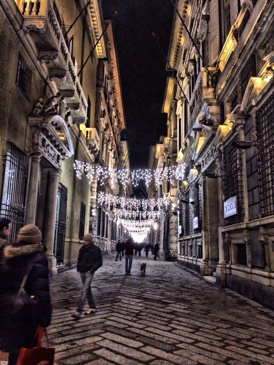 architecture, built structure, walking, building exterior, real people, illuminated, night, men, lifestyles, city, outdoors, people