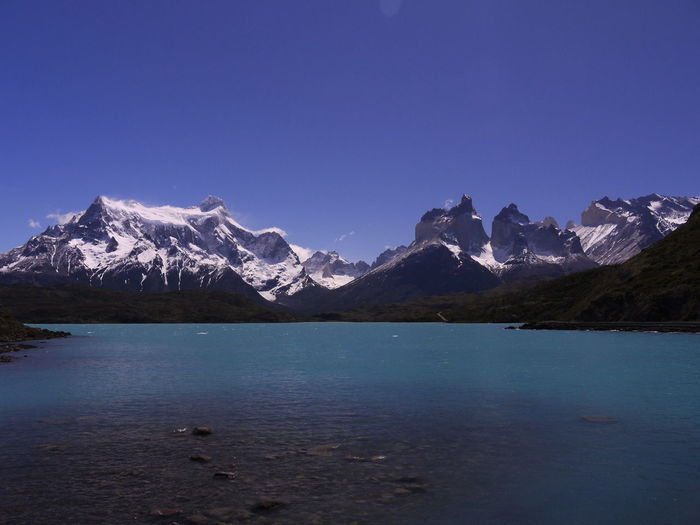Scenic view of snowcapped mountains against blue sky. torres del paine mountains, chile