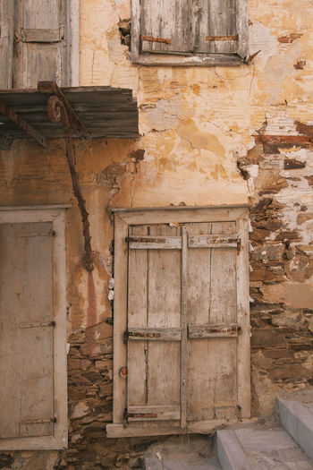 A home in Syros Home Abandoned Architecture Building Exterior Built Structure Damaged Day Greece House Indoors  Island Home No People Old Old Ruin Raw Material Street Streetscapes Syros Ermoupoli Greece Weathered