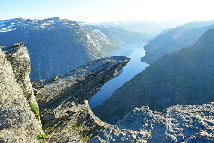 trolltunga cliff in norway Mountain Scenics - Nature Beauty In Nature Mountain Range Tranquility Water Nature Day Sky No People Environment Rock Landscape Outdoors Mountain Peak Non-urban Scene Norway Stone Trolltunga Cliff Hike Hiker