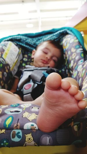 the sons foot Childhood Human Hand Child Smiling Close-up Family Bonds Cellphone