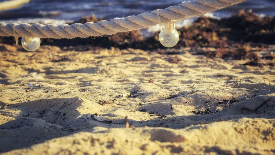 Close-up of rope on sand