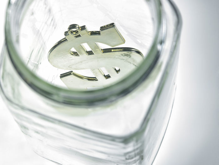 High Angle View Of Dollar In Glass Jar